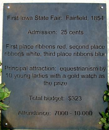 Sign at the Iowa State Fair about Fairfield's first fair.